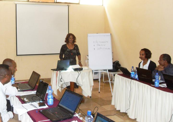 A presenter conducts a technical update training on modeling tools for health and development in Addis Ababa.