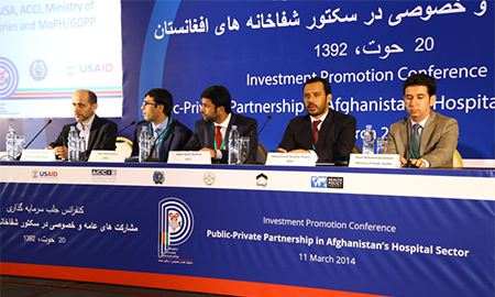 Image of HPP staff meeting at an investment promotion conference