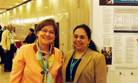 Image of Karen Hardee and Laili Irani at Health Systems Research symposium in Beijing.
