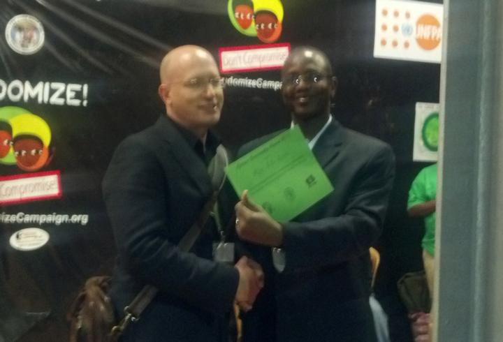 Image of Ron MacInnis receiving award at ICASA conference in Addis Ababa, Ethiopia.
