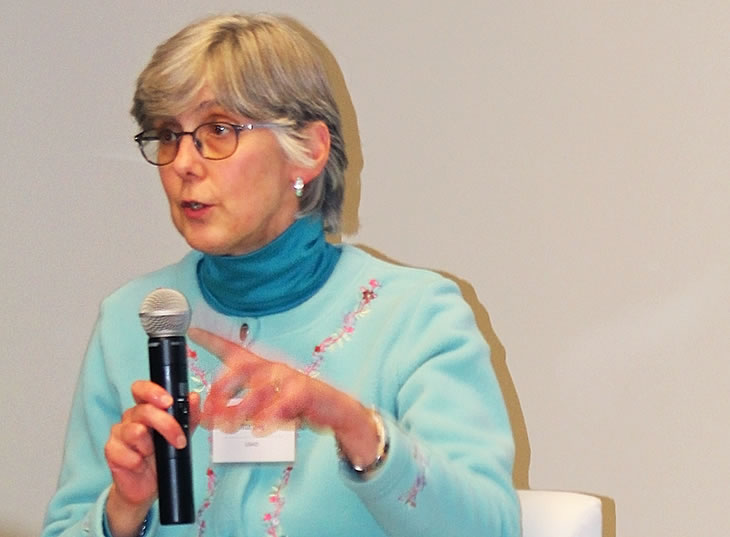 Photo of Ellen Starbird presenting the Keynote.