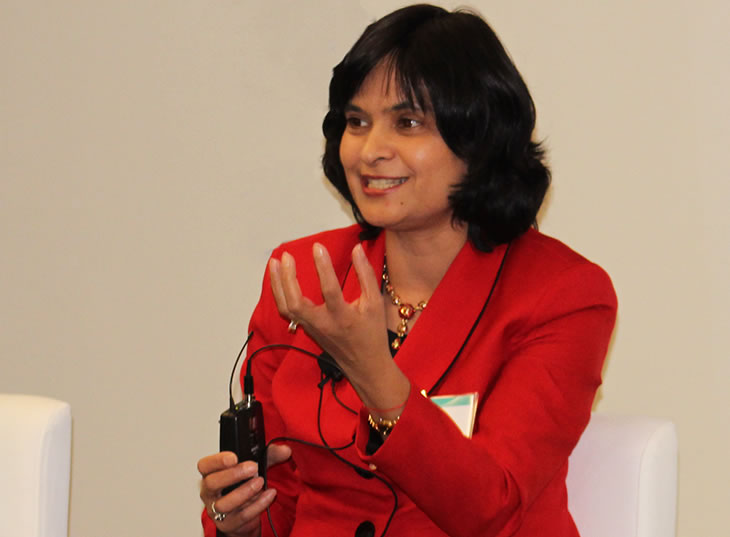 Photo of Suneeta Sharma talking animatedly.