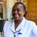 A Kenyan health worker smiles
